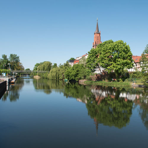 Sankt-Marien-Andreas-Kirche am Alten Hafen in Rathenow Cathedral Church Havel River Havelland Germany Rathenow Sankt-Marien-Andreas-Kirche Stadtkanal Tourist Attraction  Architecture Building Building Exterior Built Structure Evangelism Nature No People Outdoors Plant Reflection Religion Sky Springtime Tree Water Waterfront Westhavelland