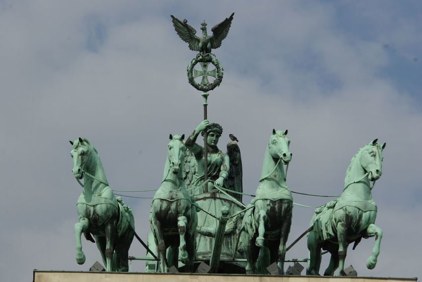 Berlin-Mitte Brandenburg Gate Deutschland Quadriga Art And Craft Brandenburger Tor Day Germany Green Color Horse Human Representation No People Outdoors Sculpture Sky Statue