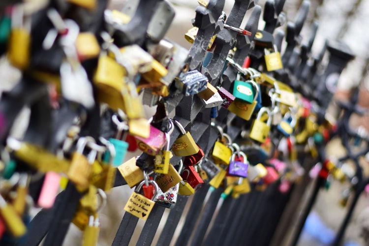 Close-Up Of Love Locks On Bridge Railing