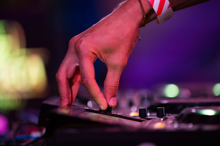 Cropped Hand Of Musician Adjusting Audio Equipment