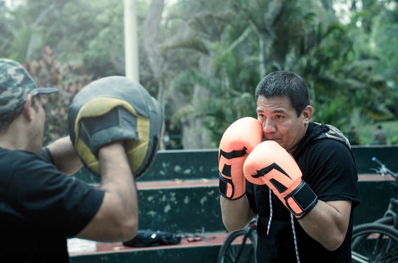 Man practicing boxing outdoors