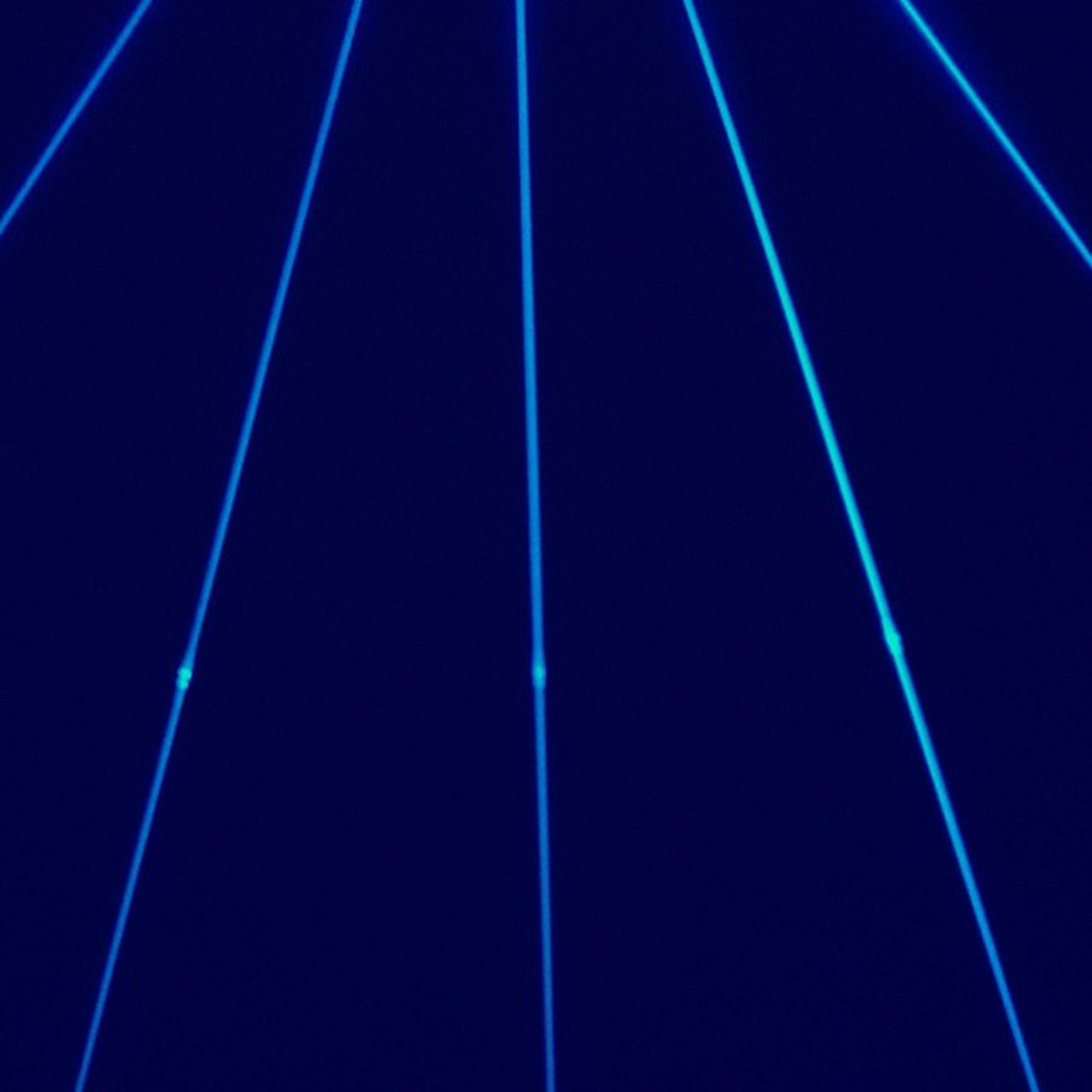 blue, low angle view, illuminated, night, lighting equipment, electricity, backgrounds, light - natural phenomenon, pattern, copy space, no people, outdoors, full frame, electric light, technology, abstract, street light, purple, sky, multi colored