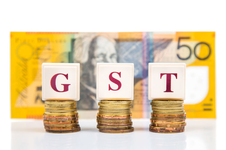 GST of Goods and Services Tax concept with a stack of coin an Australian Dollar Australia Currency Economy Government Revenue Accounting Australian Dollars Coins Conceptual Finance Goods And Services Tax Gst Income Income Tax Investment Spending Studio Shot Tax White Background