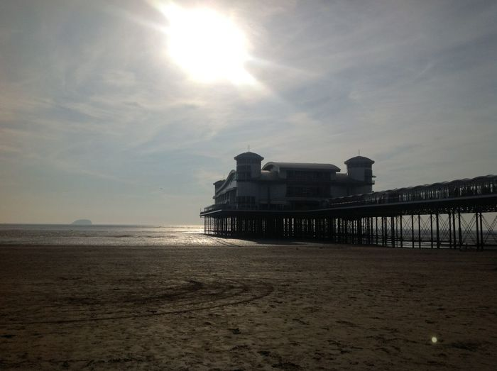 UK beach Architecture Beach Beauty In Nature Building Exterior Built Structure Day Horizon Over Water Ipod Nature No People Outdoors People Sand Scenics Sea Sky Sun Sunlight Sunset Tranquility Water