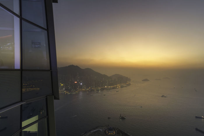 view from Sky100 Hongkong Hong Kong Hong Kong City Hong Kong Architecture HongKong Hongkong Photos Architecture Beauty In Nature Building Exterior Built Structure City Cityscape Hongkongphotography Mountain Nature Night No People Outdoors Scenics Sea Sky Sky100 Sky100hk Sunset Travel Destinations Water