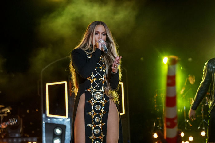 Jennifer Lopez pre-taping a performance for the 2017 Macy's Fourth of July Fireworks held in Long Island City, NY. Artist Celebrity Concert Costume Instruments Jennifer Lopez Jlo Microphone Microphones Music Musician Night Nightphotography Outdoors Performing Singer  Singing Solo Stage Train