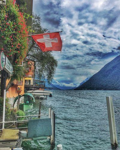 Cloud Cloud - Sky Day Flag Gandria Lago Di Lugano  Lagoon Lake Nature No People Patriotism Sea Sky Suisse  Swiss Switzerland Water