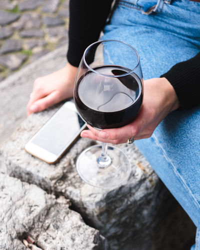 Holding Food And Drink Drink Refreshment Glass One Person Day Human Hand Real People Hand Human Body Part High Angle View Midsection Adult Outdoors Pouring Alcohol Leisure Activity Freshness Red Wine Tray