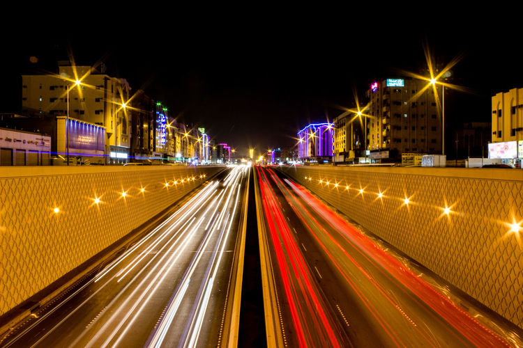 Light Blurred Motion Building Exterior Built Structure City Life City Street Cityscape Highway Illuminated Light Trail Long Exposure Motion Multiple Lane Highway Night No People Office Building Exterior Outdoors Road Speed Street Street Light Traffic Transportation Tunnel Tunnel Of Light