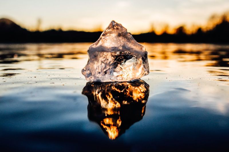 Close-Up Of Ice Floating On Lake Sky During Sunset