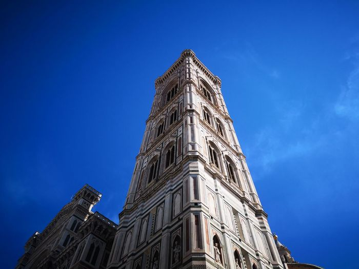 Low angle view of historic building against blue sky