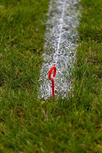 High angle view of cross on field