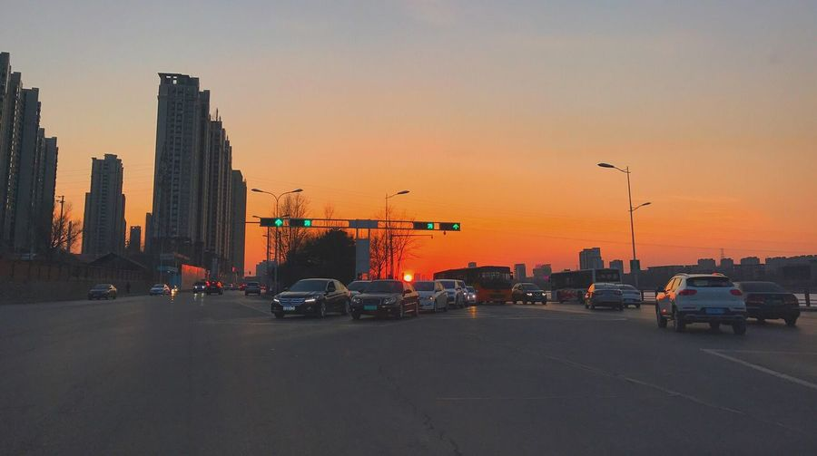 Car Sunset Transportation Orange Color Building Exterior Cityscape Mode Of Transport Land Vehicle No People First Eyeem Photo Women Around The World