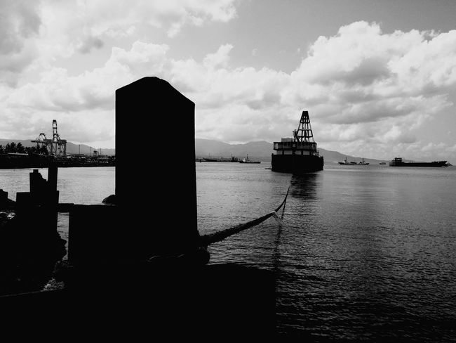 (Like a ) Ship on a Leash, one cannot reach the farthest reaches of the ocean when it is tied to land. Ship Sea Black And White Photography Dramatic Black And White Freedom Leash Constrained Batangas, Philippines Eyeem Philippines Feeling Down Fine Art Photography Water Nautical Vessel Sky Transportation Harbor Cloud - Sky Mode Of Transport Waterfront Day Outdoors Built Structure No People Silhouette Commercial Dock Sailing Architecture Shipyard Sailing Ship Building Exterior
