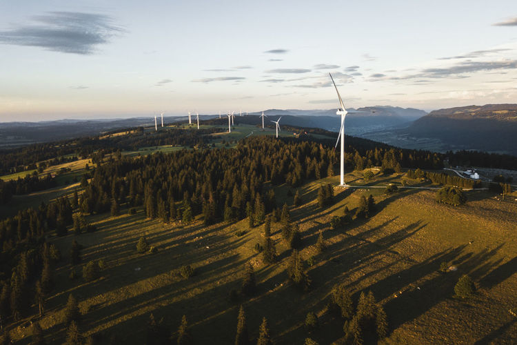 Mont Soleil Wind Turbine Wind Power Windmill Alternative Energy Dronephotography Fuel And Power Generation High Angle View Industrial Windmill Landscape Outdoors Renewable Energy Scenics Sunset