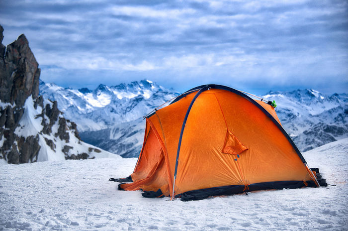 A lonely orange tend stands very close to the top of Mont Blanc, Between Italy and France. At their return from conquering the highest peak in Europe , the mountaineers will get some much deserved rest in their high altitude bivouac. Alpine Mont Blanc Massif On Top On Top Of The World Active Lifestyle  Adventure Alpinism Alps Bivouac Camping Cold Temperature High Altitude Lifestyles Mont Blanc Mountain Mountain Peak Mountaneering Nature No People Orange Color Outdoors Scenics Snow Tent Winter