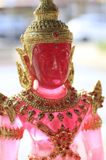 Statue Of Buddha Statue Emerald Buddha Temple Emerald Buddha Focus On Foreground Close-up Art And Craft No People Human Representation Celebration Creativity Representation Red Sculpture Day Indoors  Statue Holiday Still Life Christmas Craft Clothing Ornate