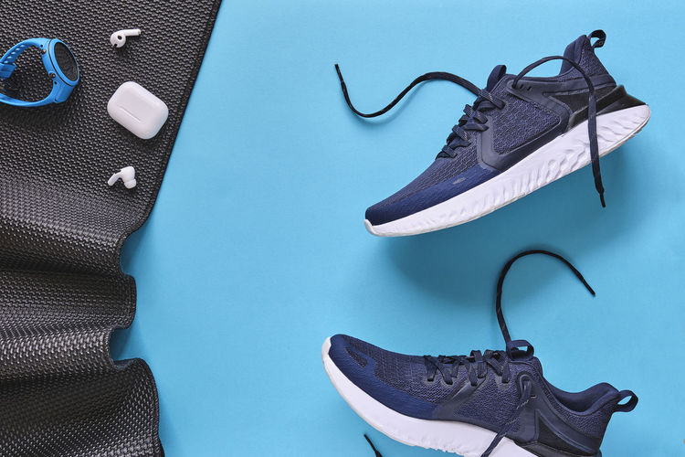 High angle view of shoes against blue background
