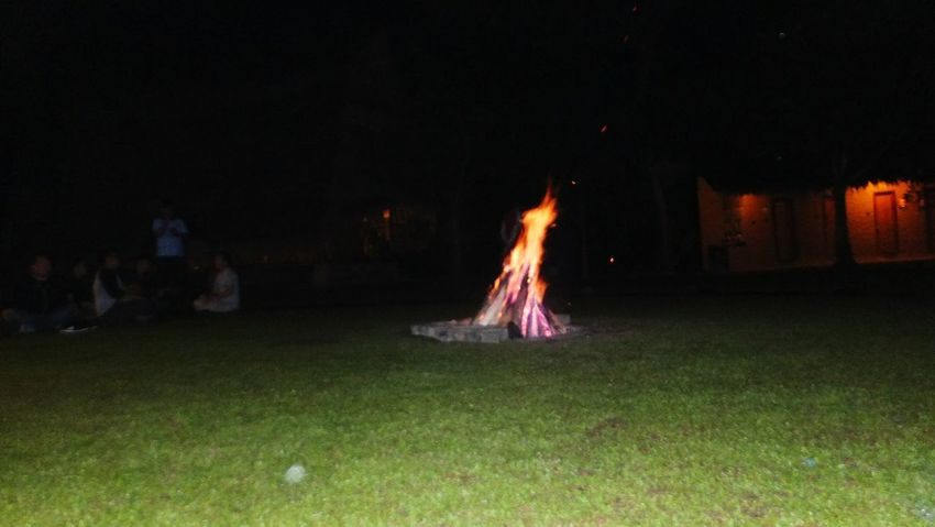 EyeEm Selects Burning Night Flame Glowing Illuminated Bonfire Celebration Outdoors Grass Arts Culture And Entertainment No People Tree Sky Camping Heat - Temperature Fireball And The View Fire And Flames