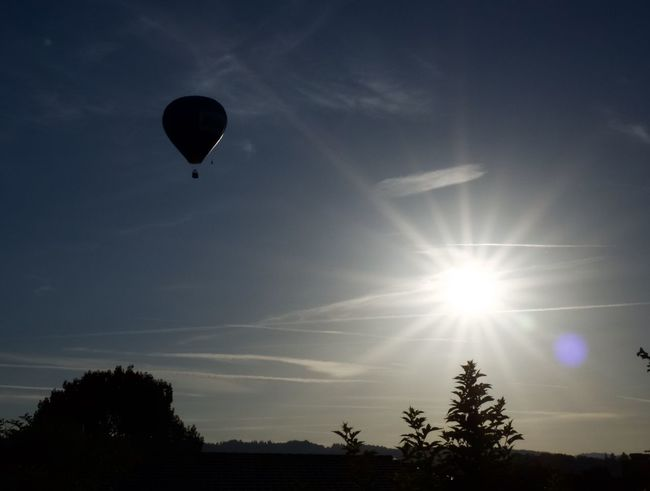 I woke up by the sound of the burning gas and I knew what it is Early Sunday Morning EyeEm Gallery Flare Flying From My Point Of View Hot Air Balloon Low Angle View Mid-air Morning Pivotal Ideas Sky Sun Sunlight Tranquility