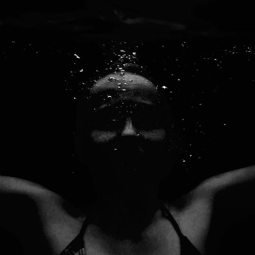 Close-up of woman swimming in water