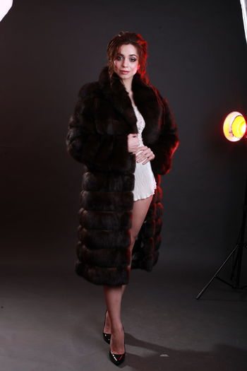 Beautiful Woman Indoors  Clothing Standing Studio Shot Studio Photography Editorial Photography Elégance Warm Clothing Fur Coat Fur Glamour Fashion Model Gray Background Full Length Front View Adult Women Real People Holding Smiling Confidence  Lighting Equipment Looking Hairstyle