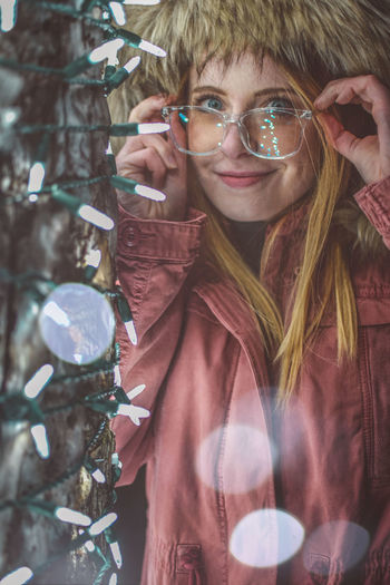 Portrait Looking At Camera One Person Front View Real People Glasses Young Adult Holding Leisure Activity Lifestyles Women Smiling Young Women Standing Tree Hairstyle Casual Clothing Day Outdoors Pre-adolescent Child