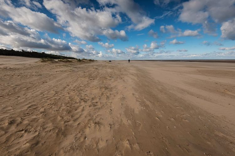 Sandy Blue Dog Walking Landscape_photography Beach Life Beachphotography Blue Sky Seaside Norfolk North Norfolk Wells-next-the-Sea Nikon Nature Photography Sky Land Sand Cloud - Sky Environment Scenics - Nature Beach Landscape Horizon Sand Dune Travel Destinations