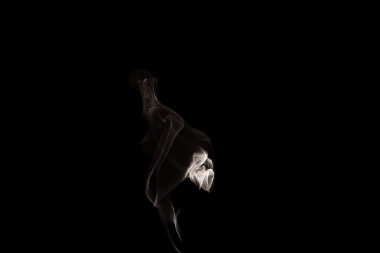 Side view of smoke against black background