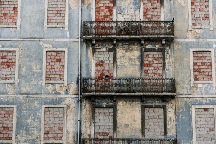 Portugal Abandoned Architecture Backgrounds Brick Brick Wall Building Building Exterior Day Decline Deterioration Full Frame Lisbon No People Old Outdoors Pastel Colors Residential District Ruined Travel Destinations Weathered