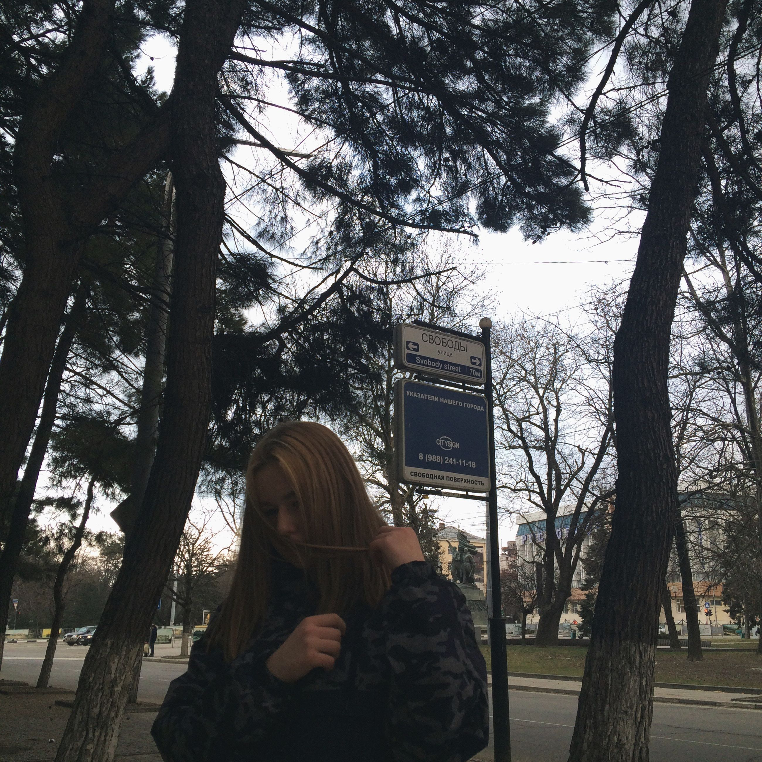 tree, women, one person, real people, people, young women, technology, only women, young adult, adult, day, adults only, one woman only, outdoors, sky, architecture, one young woman only
