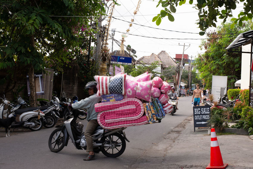 only in bali Bali Big Load Carrying Scooter Architecture City Day Incidental People Land Vehicle Mattress Men Mode Of Transportation Motorcycle Nature Outdoors Real People Riding Road Stars And Stripes Street Streetphotography Transportation