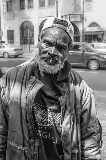 Close-up of a man with city street