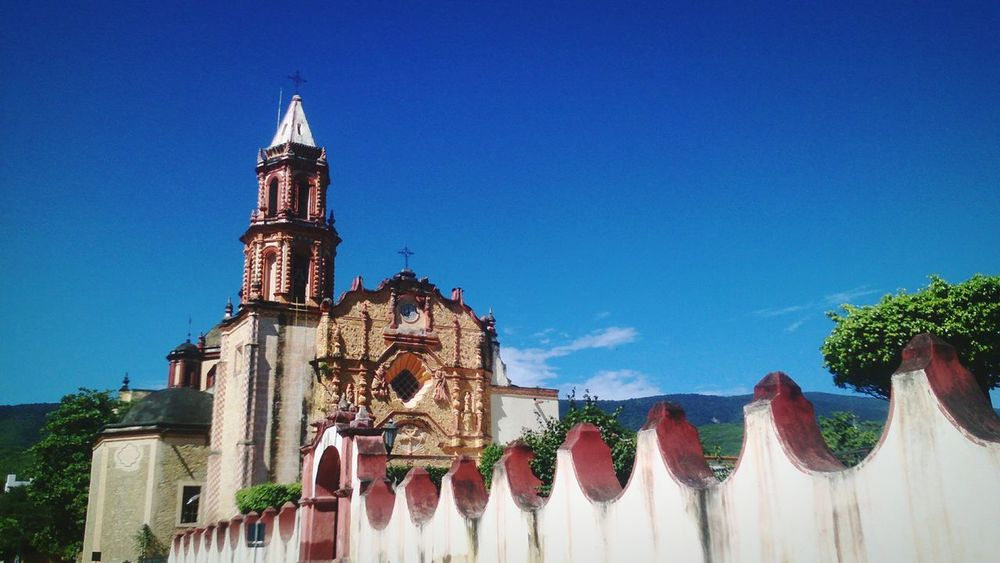 Blue Sky Architecture Travel Destinations No People Clear Sky Outdoors Building Exterior Day Tree MisionsFranciscanas Culture Catolic Church Catolicism Barroco Towers And Sky Tower Church Clock Clock