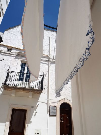 Bella Italia Bella Vita Blue Color La Dolce Vita Locorotondo Puglia South Italy Architecture Blue Building Exterior Built Structure Flag Folk Folklore Houses And Windows Low Angle View No People Outdoors Sud Italia White White And Blue White Color