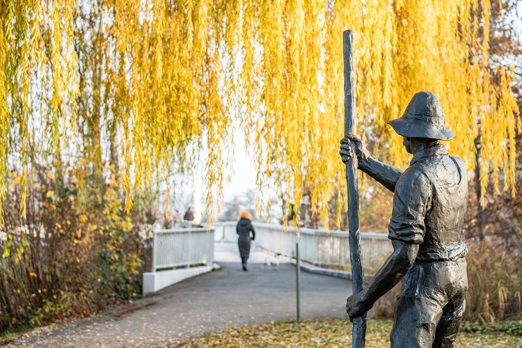 Tree Autumn Plant Nature Day People Real People Rear View Standing Park - Man Made Space Park Change Outdoors Clothing Men Railing Leaf Walking Group Of People Adult Government Ferryman