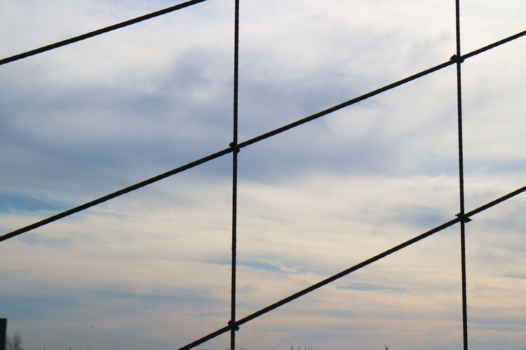Cloud - Sky Sky No People Metal Day Nature Full Frame Low Angle View Protection Pattern Outdoors Backgrounds Security Close-up Focus On Foreground Safety Cable Rod Architecture Built Structure Power Supply
