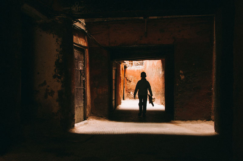 Silhouette Boy Walking In Building