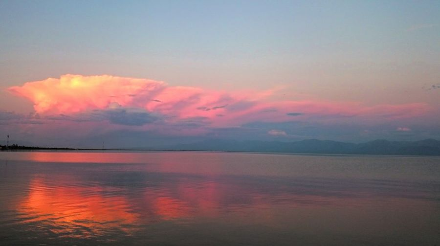 Water Scenics Tranquil Scene Sunset Tranquility Waterfront Beauty In Nature Sea Sky Idyllic Orange Color Nature Reflection Majestic Cloud - Sky Cloud Seascape Dramatic Sky Calm Blue