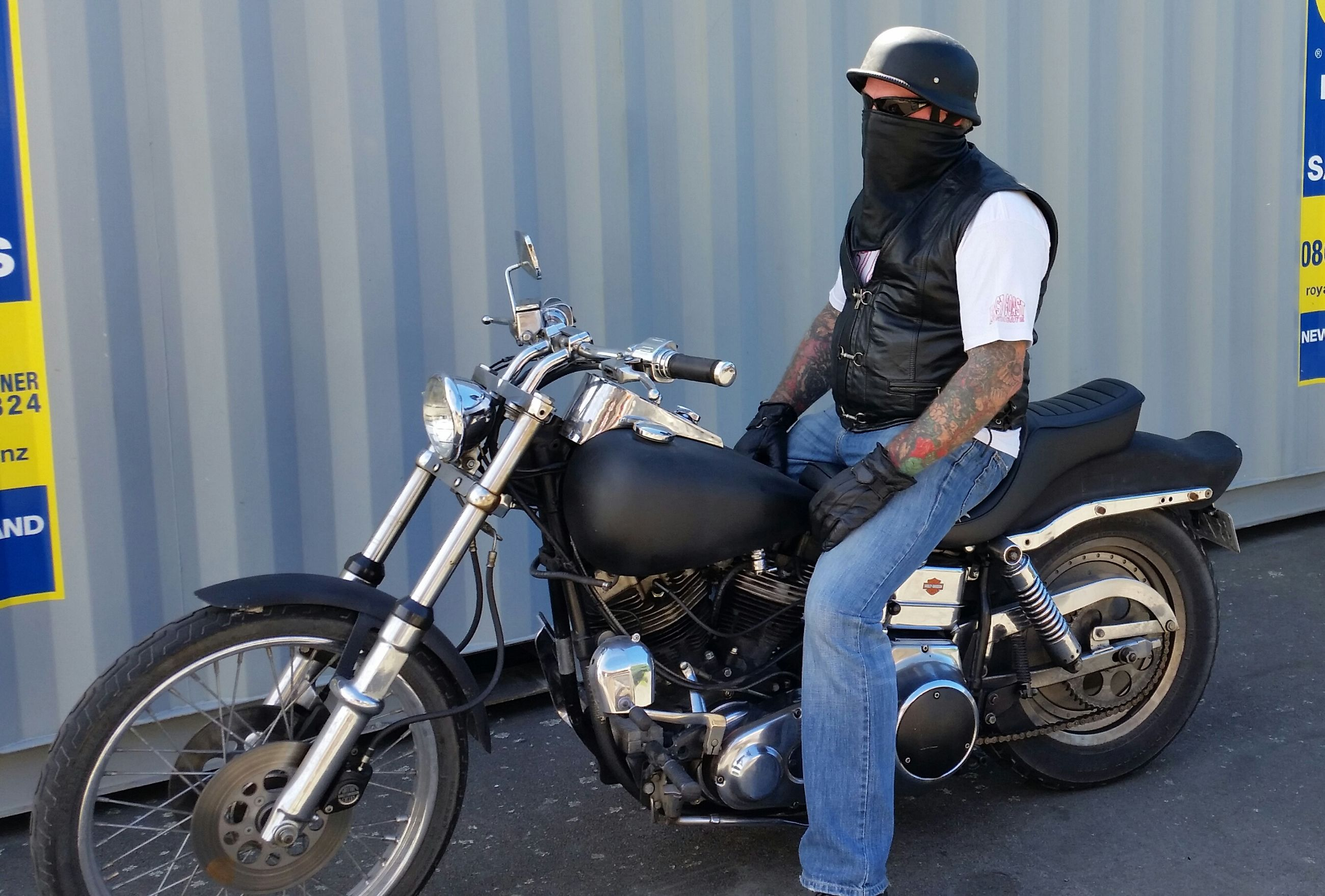 motorcycle, transportation, one person, mode of transport, biker, adults only, one man only, outdoors, stationary, only men, helmet, day, people, headwear, men, adult