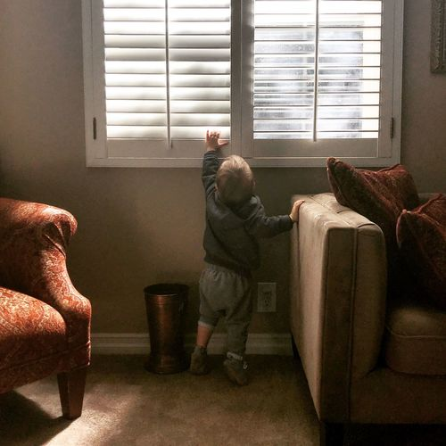 Playing Tippytoes Windowlight Window Exploring Toddlerlife Toddler  EyeEm Selects Window Indoors  Child Full Length Childhood Rear View Home Interior Lifestyles Boys Sofa Real People