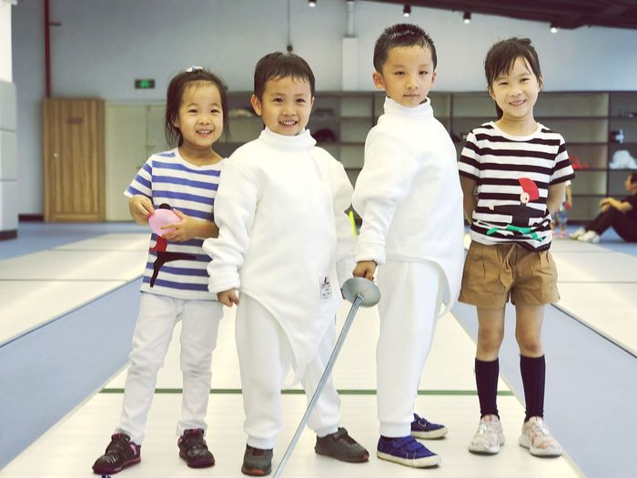 So cute. little idol. Looking At Camera Childhood Boys Full Length Portrait Child Standing Striped Smiling Elementary Age Front View Girls Togetherness Casual Clothing Fun Leisure Activity Happiness Real People Day Friendship