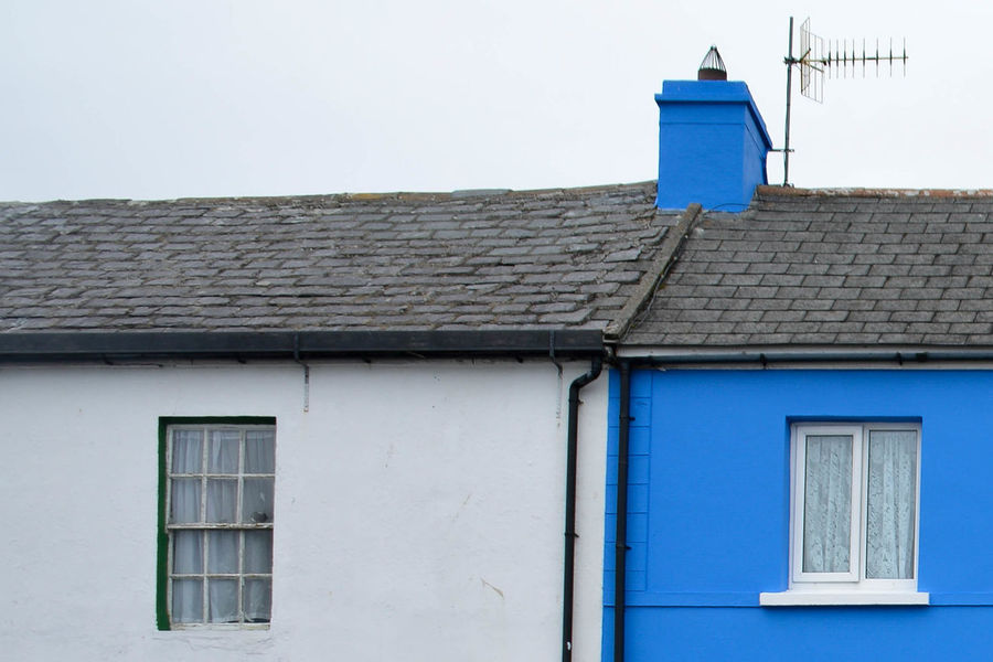 Aerial Architecture Blue Blue Paint Building Exterior Built Structure Chimney Chimney Stacks Chimneys Day House Low Angle View No People Outdoors Residential Building Roof Rooftop Rooftops Sky Tiled Roof  Tiles Tiles Textures Tv Aerial White Window