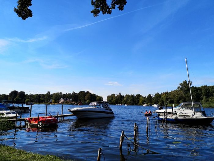 a day at the lake Lake Summertime Tree Water Nautical Vessel Sea Harbor Moored Yacht Beach Pedal Boat Blue Motorboat Marina