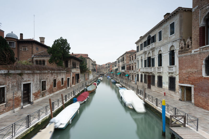 Canal passing through city buildings