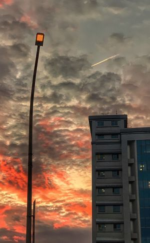 iPhone XS Sky Cloud - Sky Sunset Building Exterior Built Structure Low Angle View No People Orange Color Beauty In Nature Outdoors Building Technology Architecture Dramatic Sky Nature Dusk Communication Tall - High Street Street Light