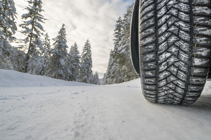 car with winter tire on slippery road Cars Country Ice Road Rural Security Tires Travel Close-up Cold Temperature Countryside Danger Icy Lane Nature No People Outdoors Slippery Snow Tire Tire Track Transportation Tyre Wheel Winter