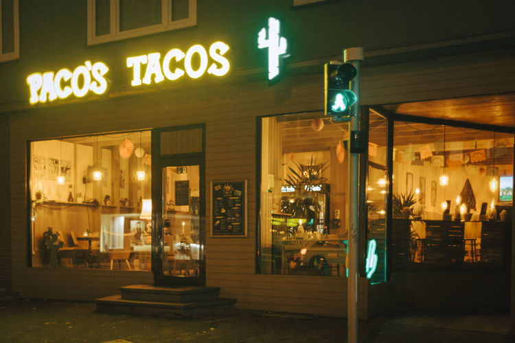 Illuminated restaurant at night
