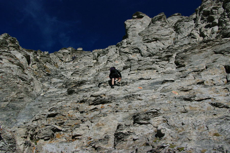 Adventure Animal Themes Beauty In Nature Climbing Day Domestic Animals Extreme Sports Hiking Low Angle View Mammal Mount Olympus Mountain Nature One Person Outdoors People Real People Rock - Object Rocky Mountains Sky