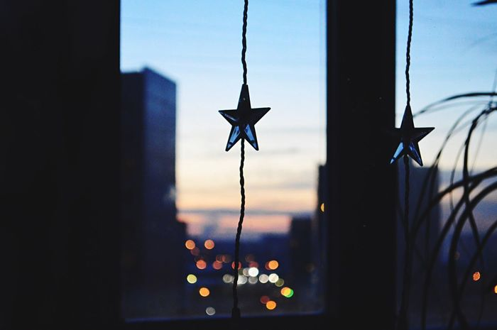 ✨🌟⭐️ Silhouette No People Close-up Wind Chime Indoors  Sky Day Hanging EyeEm Eyemphotography Winter Eye4photography  Lovephotography  Eyeemphoto Atmospheric Mood NewYear Backgrounds Christmas Ornament Light And Shadow Star Evening Bokeh Photography Lights Citylights Cityview